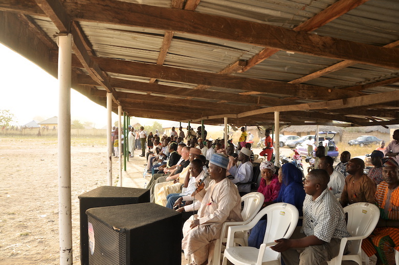 The announcer calls the plays from the grandstand at the pro-conservation football match organized by the Gashaka Biodiversity Project last February. Photo by Lawal Sani Kona.