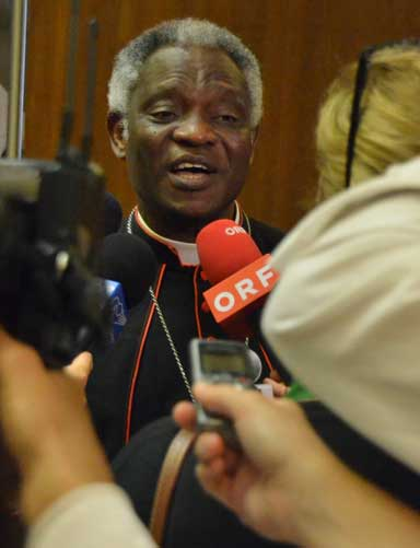 Cardinal Turkson often now finds himself surrounded by world media and acting as a spokesperson for the pope's encyclical on climate change. Photo courtesy of the Vatican