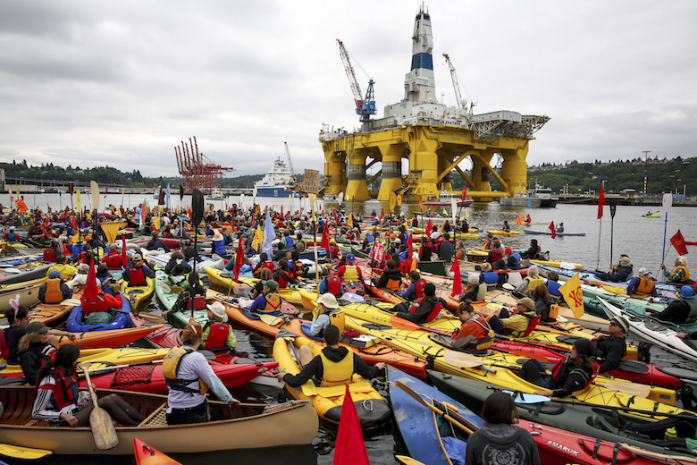 Activists gathered to protest Shell's Polar Pioneer drilling rig as it docked in Seattle on its way to the Arctic in May 2015. Photo by Backbone Campaign/Flickr.
