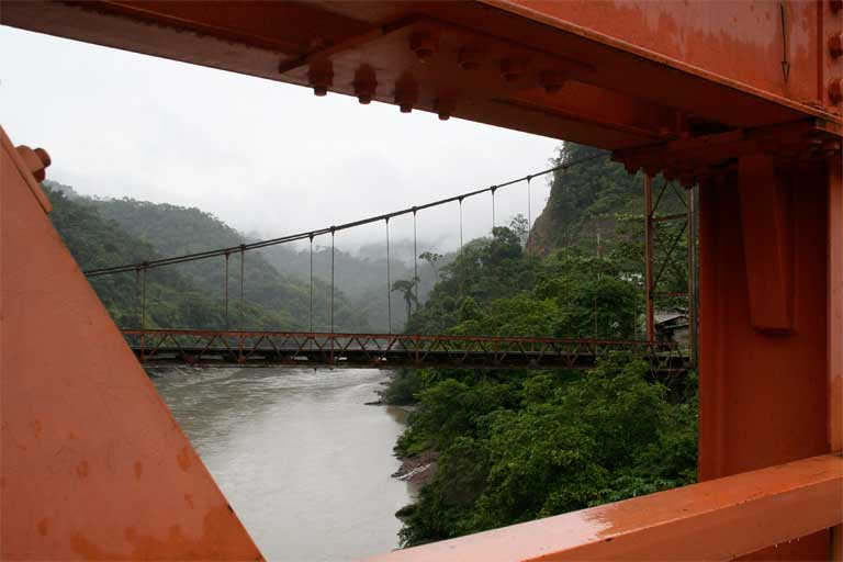 The old Inambari suspension bridge is framed by struts of the new one, looking upstream toward the proposed dam site. The study argues that incorporating ethical analysis into business decisions would help ensure businesses meet their commitments to sustainability, as well as promoting better behavior. Photo © Barbara Fraser