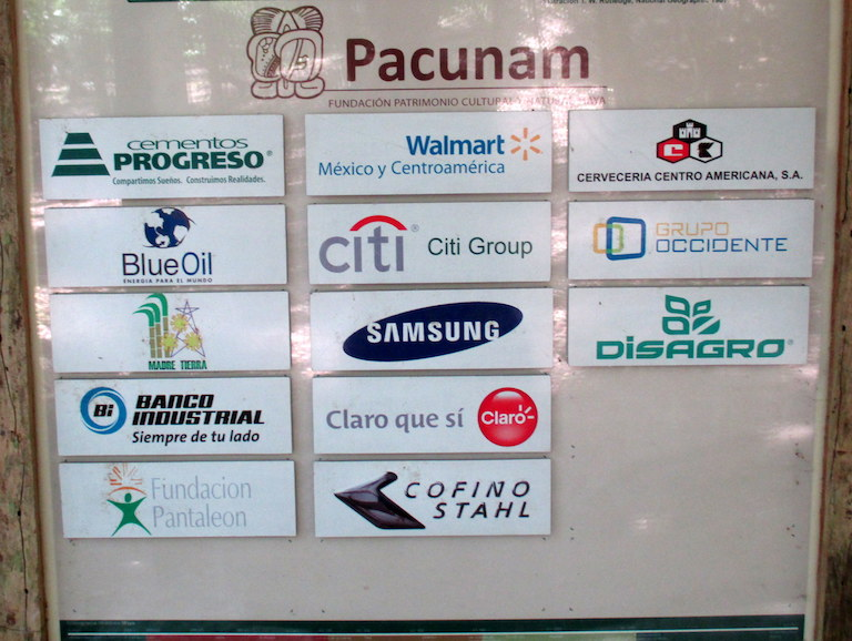 Pacunam's corporate members are listed on a sign at the Mirador archaeological site in Guatemala's Maya Biosphere Reserve. Photo by Sandra Cuffe.