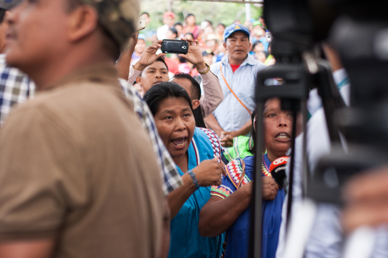Protestors begin voicing their opposition before the ceremony begins. Photo by Camilo Mejia Giraldo
