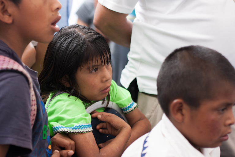 Ngäbe children watch as the ceremony to sign the agreement unfolds. Photo by Camilo Mejia Giraldo