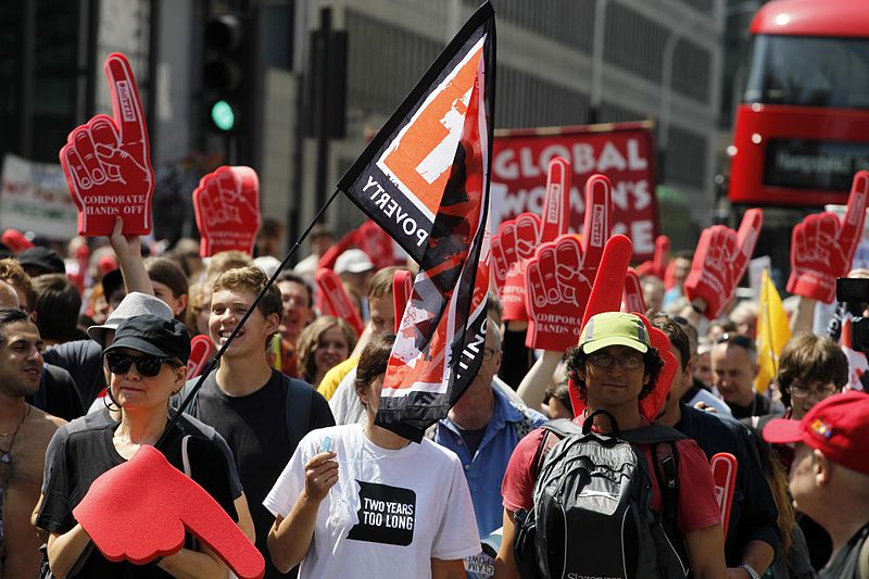 A 2014 protest in London against the proposed TTIP treaty (Transatlantic Trade and Investment Partnership). Huge public demonstrations have come out against the TTIP's secret treaty negotiations that opponents say benefit investors while endangering the environment, dismantling labor rights, and threatening democracy. Photo courtesy of the World Development Movement licensed under the Creative Commons Attribution 2.0 Generic license