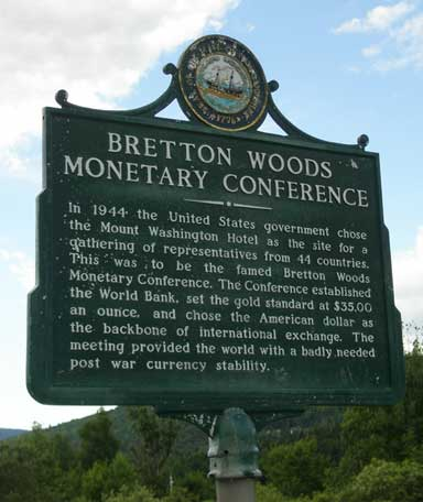 Bretton Woods Historical Marker, Carroll, New Hampshire, USA, commemorates the place where the fundamental legal mechanisms underlying modern international trade and globalization were born. Photo by JCardinal18 licensed under the Creative Commons Attribution-Share Alike 2.0 generic license