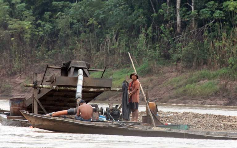 Small-scale gold mining in the Amazon. In addition to the land conflicts that exist between miners and indigenous groups, small-scale miners use mercury to process gold ore. As a result, Indians who eat mercury-contaminated fish can be sickened. Photo by Rhett A. Butler