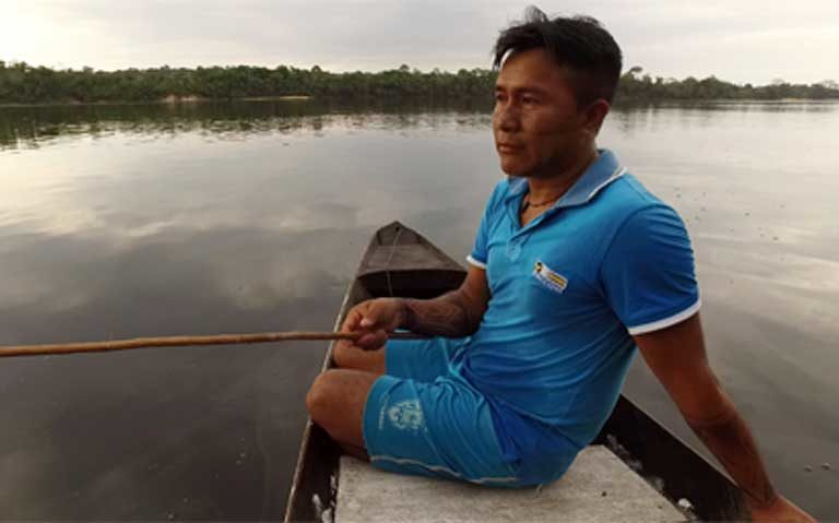 """Sandro Waro Munduruku: """"There are far fewer fish [in the Teles Pires River downstream from the dam now]. We never catch as many as we used to before the dam was built. Shoals of fish are dying. We don't know how we are going to live in the future."""" Photo by Thais Borges"""