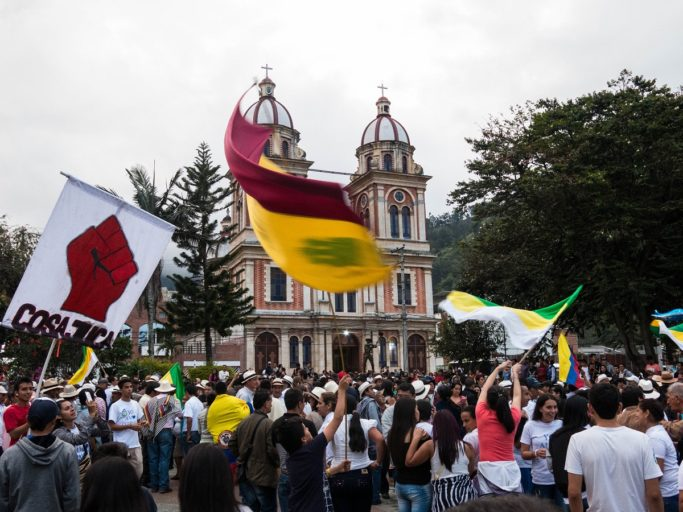 Residents celebrate in town square after the results of the vote were announced in Cajamarca, Colombia on March 26, 2017. Photo by Bram Ebus for Mongabay.