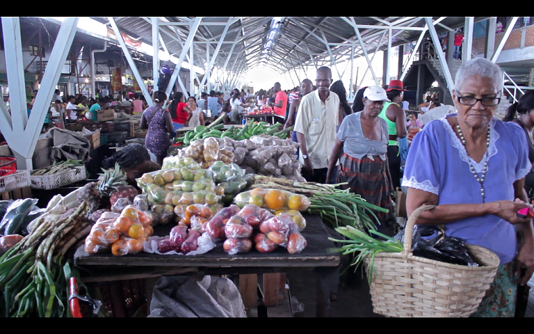 Local residents buy produce from the local market. Photo by Kimberley Brown