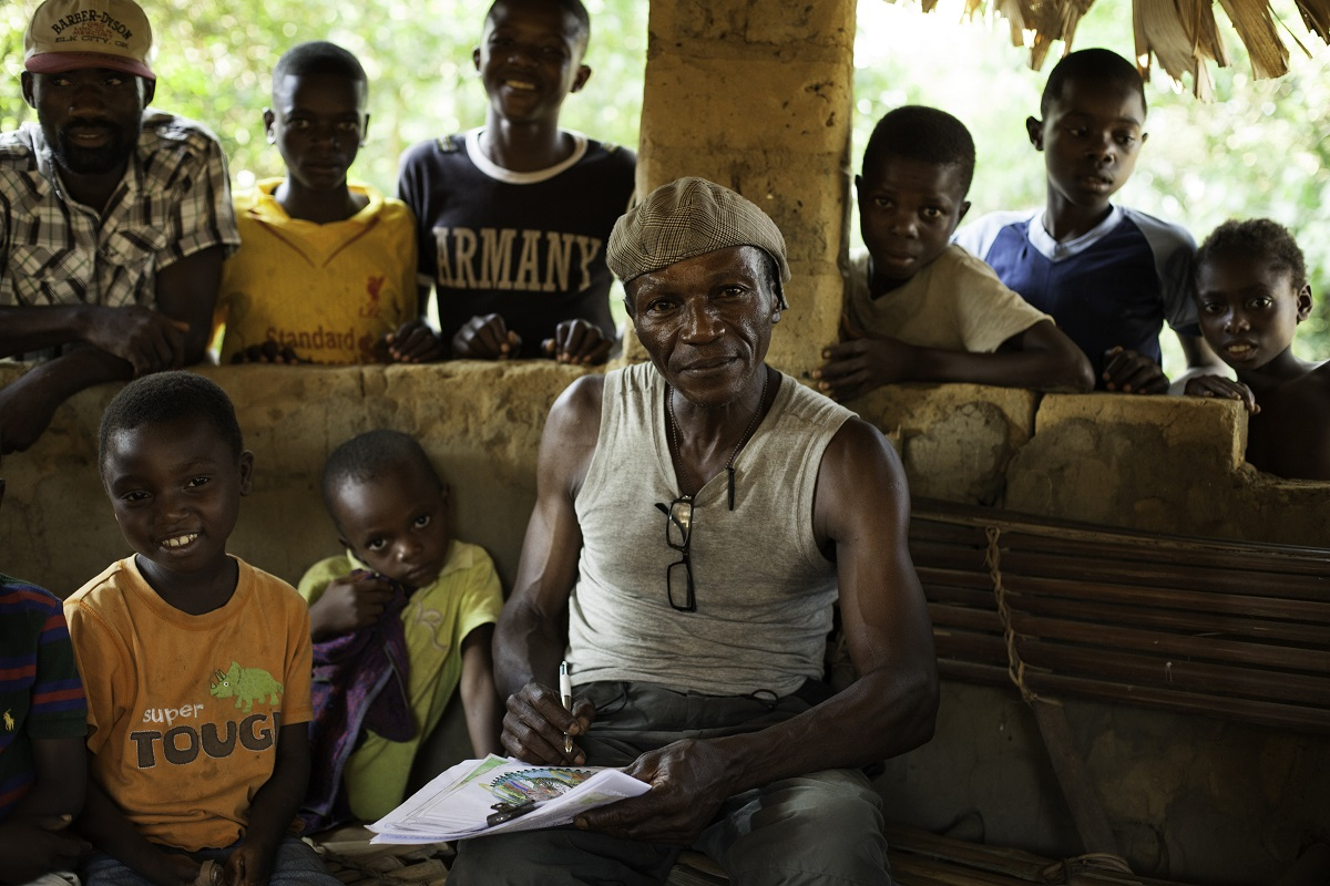 Wally, drawing to educate and raise awareness about environmental conservation among his community neighboring the Salonga National Park, Monkoto, Tshuapa, Democratic republic of the Congo, October 2016. Photo by Leonora Baumann for Mongabay