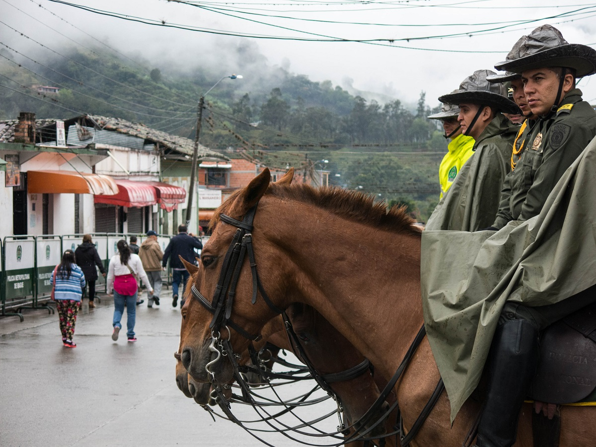 Mounted police in Cajamarca, Colombia on March 26, 2017 before the referendum vote there. Photo by Bram Ebus for Mongabay.