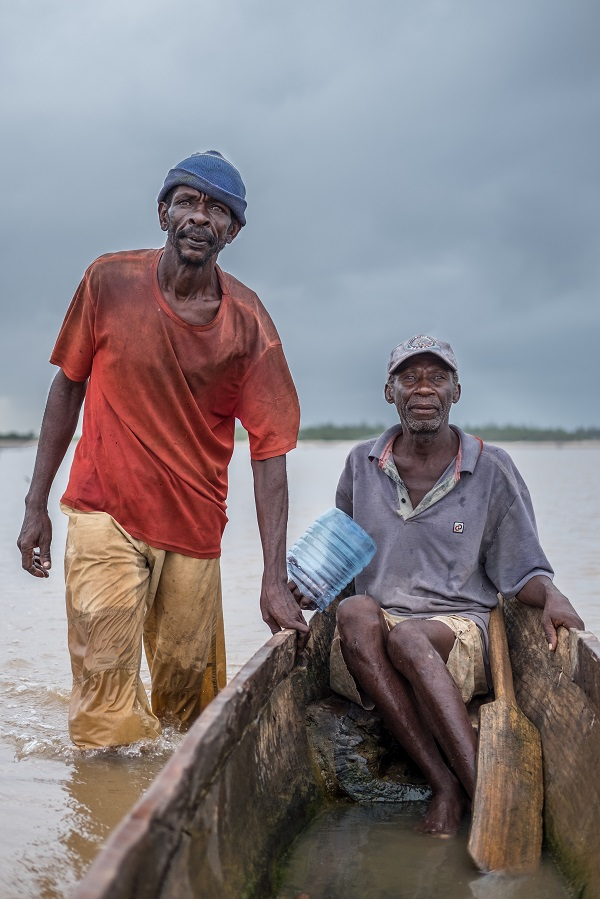 Abdu Hajy (left) and Michael Mwangona return after fishing in the Tana River Delta, on the coast of Kenya. Photo by Nathan Siegel for Mongabay.